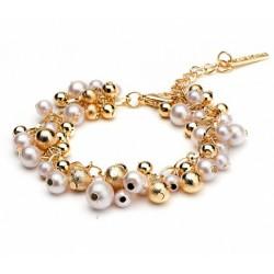 Bracelet fantaisie doré avec perles nacrées